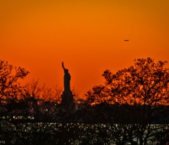 Sunsetting over New York with Statue of Liberty 2